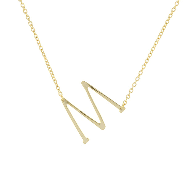 Sideways letter M necklace in gold