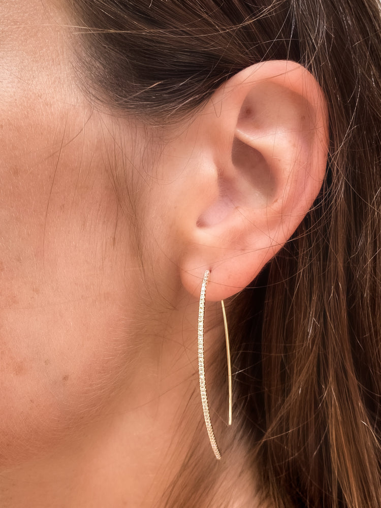 Model wearing our 14kt yellow gold and diamond thin thread-through drop earrings