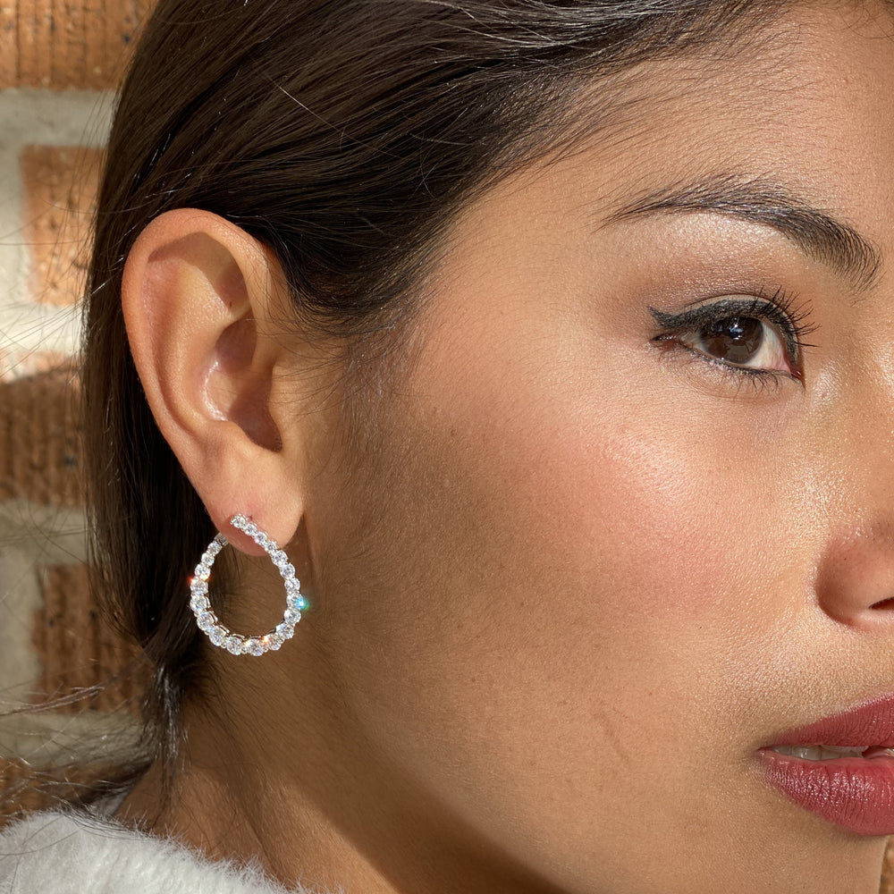 Wearing Alexandra Marks curved CZ Hollywood Silver Earrings