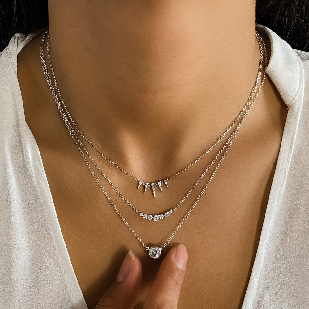 Wearing the tiny silver triangle necklace from Alexandra Marks Jewelry