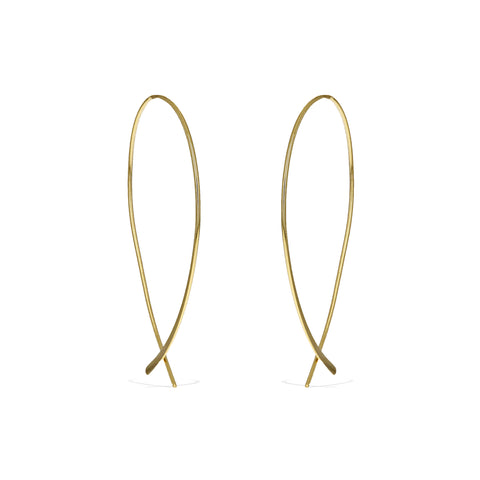 Front view of the gold criss cross earrings, showing off the simple design of the hoop earrings