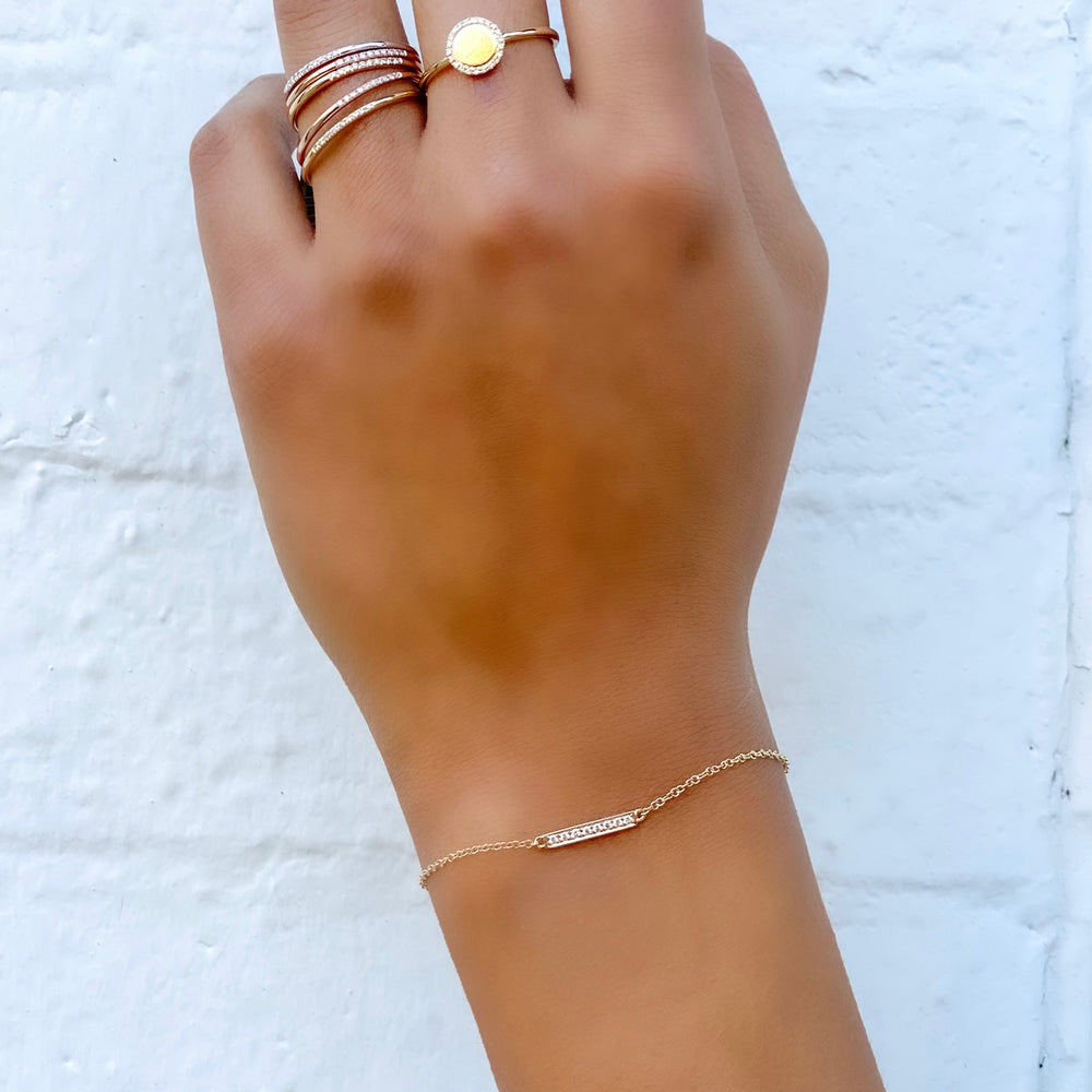 Wearing the 14kt yellow gold dainty diamond bar bracelet