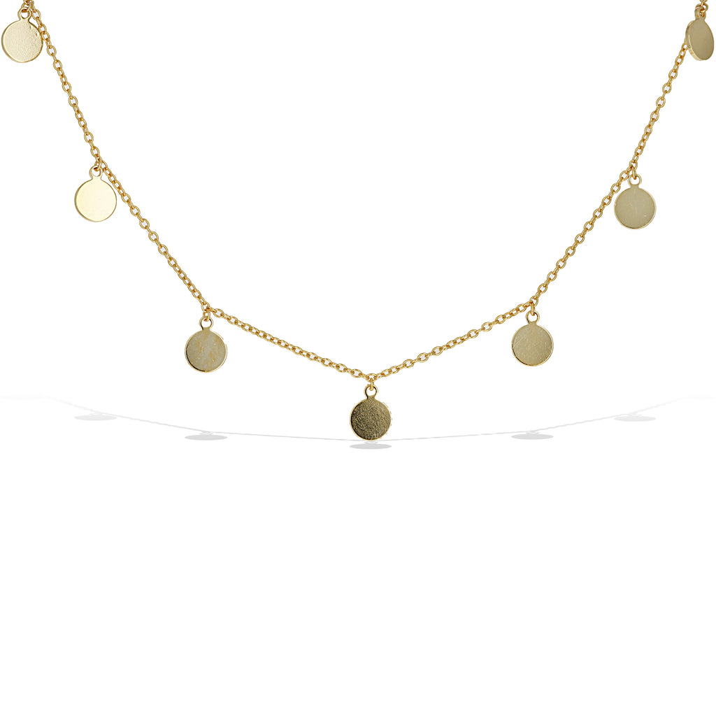 High polished plain discs hang from a thin chain necklace in gold