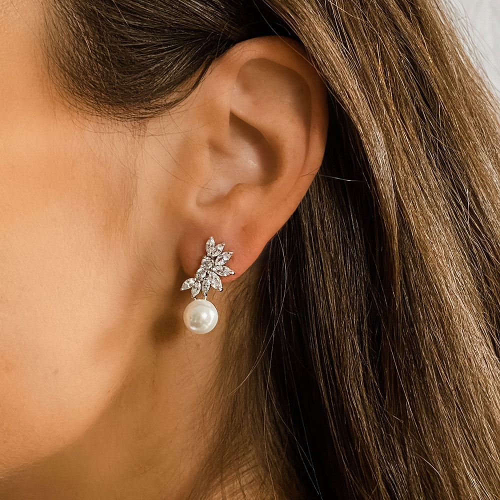 A bride in the pearl marquise bridal earrings | Alexandra Marks Jewelry