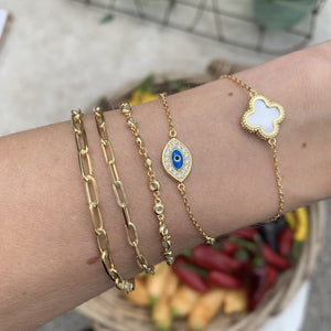 Layering our Alexandra Marks Blue Cz Evil Eye Bracelet in Gold