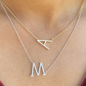 Wearing our gold & silver cz initial necklaces at Alexandra Marks Jewelry