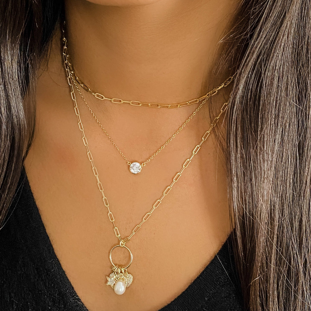 Wearing the heart, star and pearl charm necklace