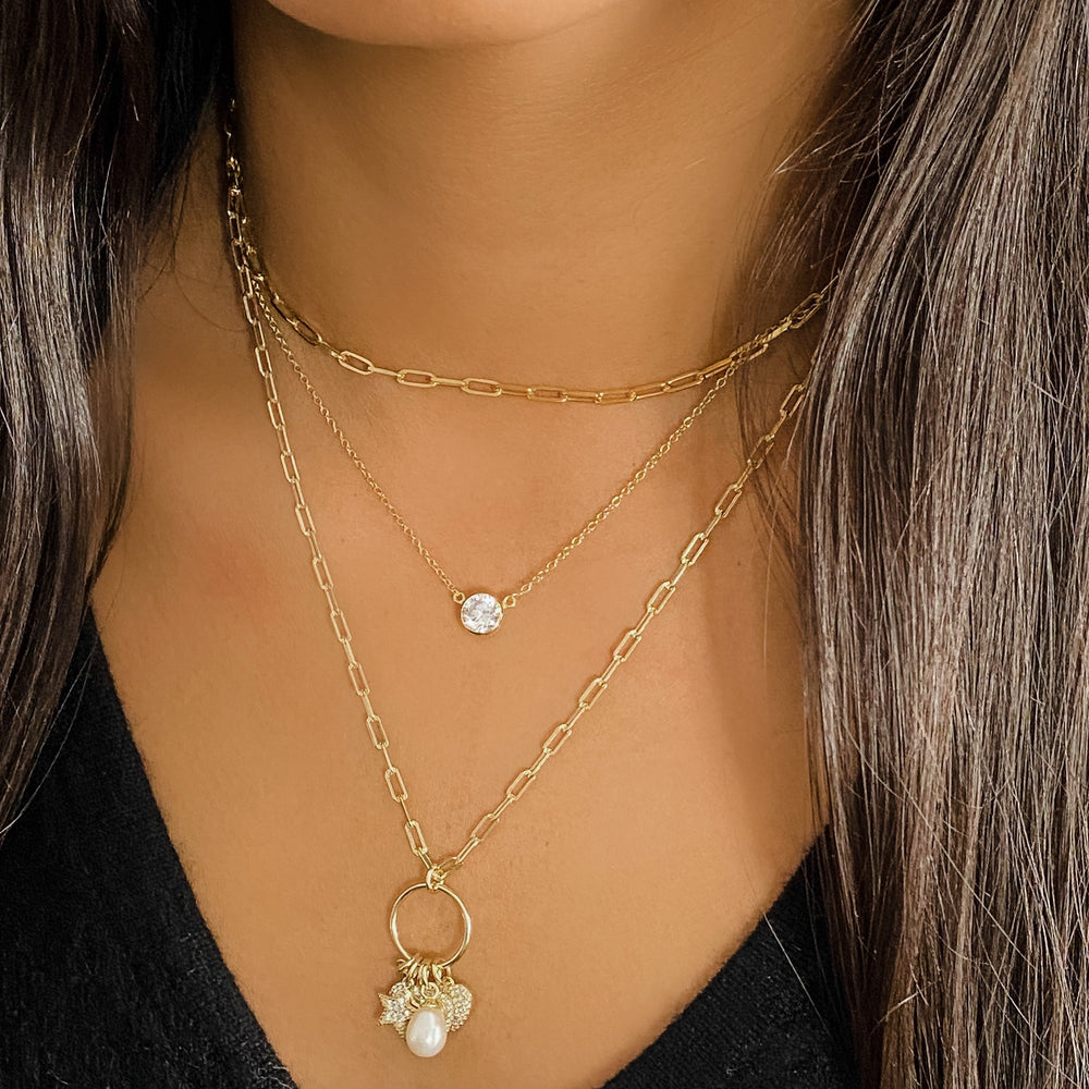 Layering our 3ctw bezel set cz necklace with two other gold AMJ necklaces