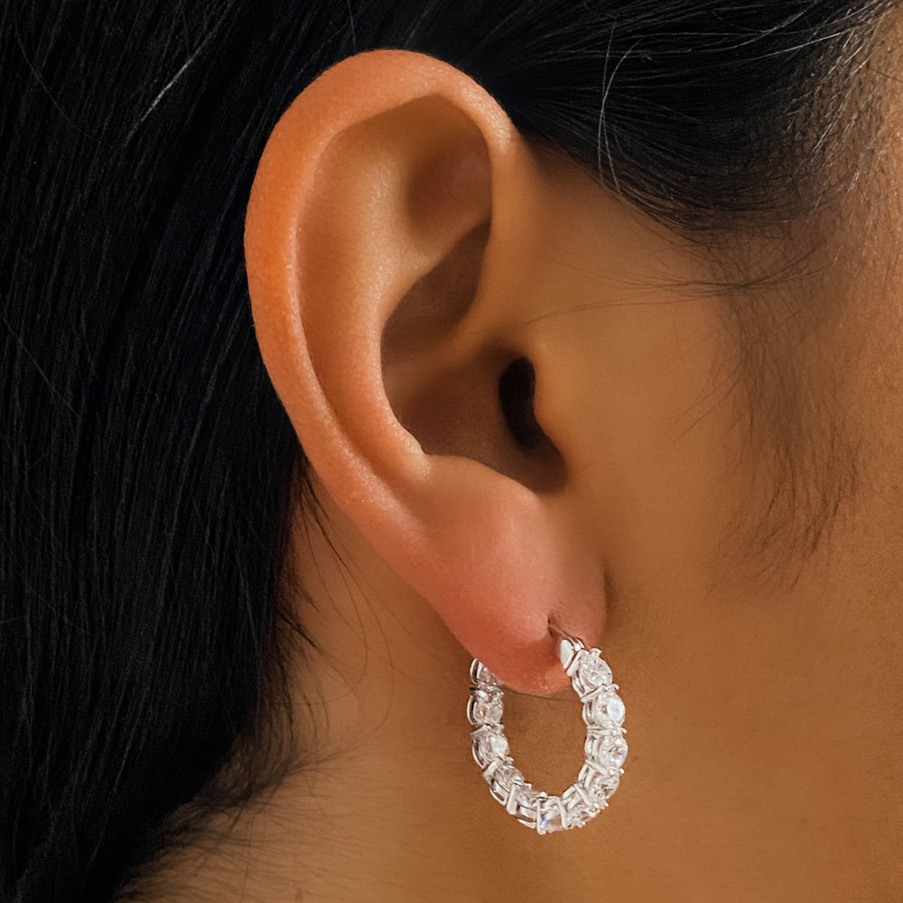 Wearing the silver 3ctw inside-outside cz hoop earrings