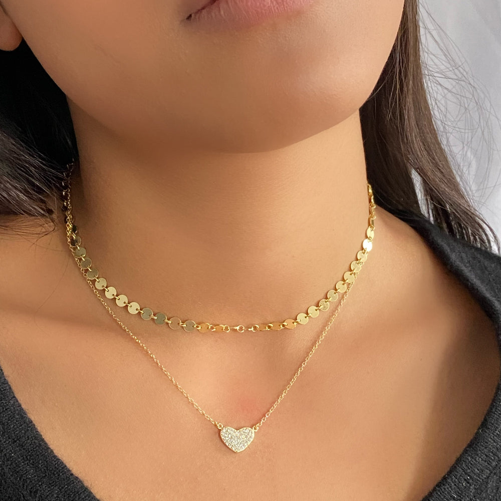 Wearing the gold sweet heart necklace