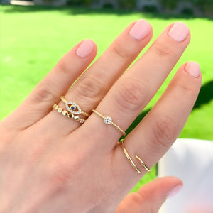 Alexandra Marks - Stacking our dainty gold rings with our small evil eye gold ring