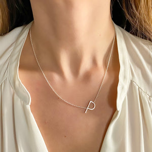 Wearing the silver letter P initial necklace from Alexandra Marks Jewelry
