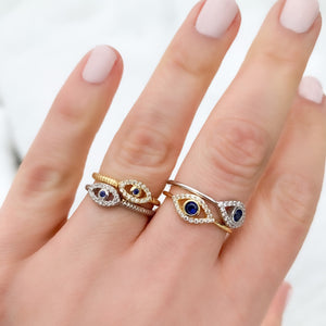 Wearing two different evil eye ring styles in gold and silver
