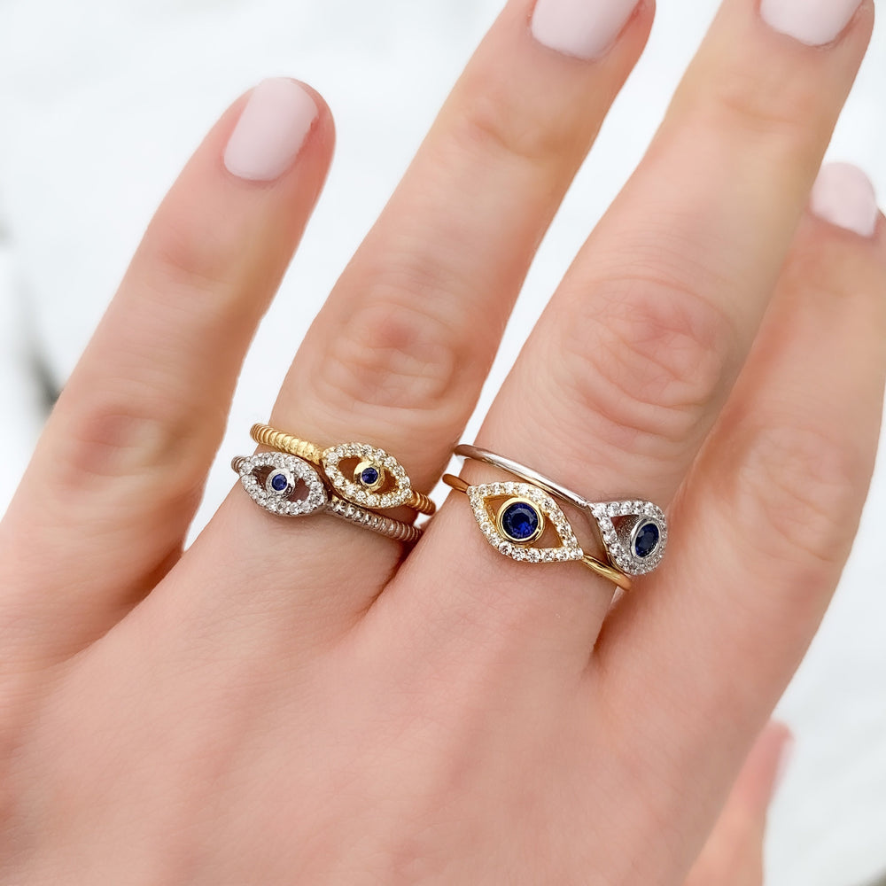 Wearing the gold & silver curved evil eye rings