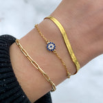 Alkexandra wearing the gold evil eye bracelet