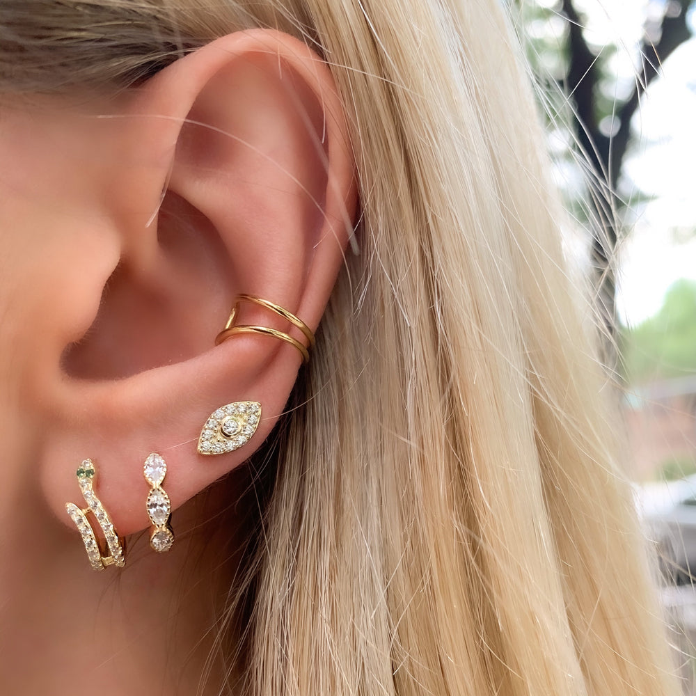 Load image into Gallery viewer, Wearing our pave' cz gold evil eye stud earrings