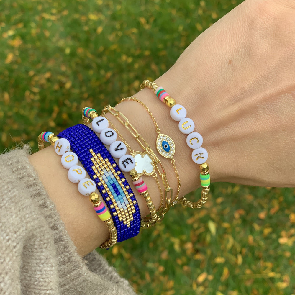 Stacking our gold evil eye bracelet at Alexandra marks Jewelry