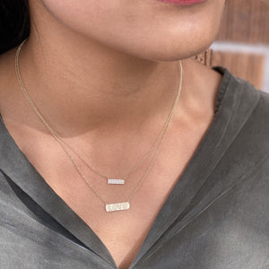 Layering our Diamond LOVE Bar Necklace at Alexandra Marks Jewelry