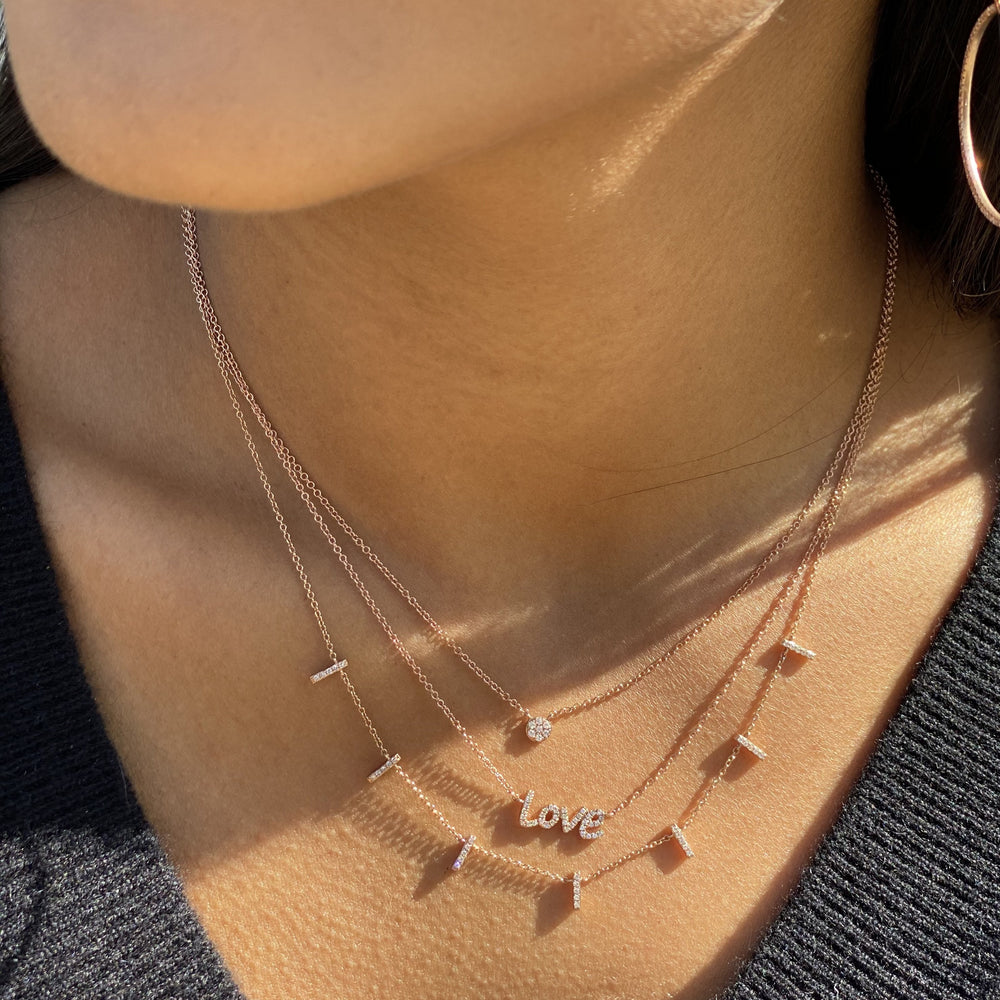 Wearing the 14kt rose gold diamond disc necklace