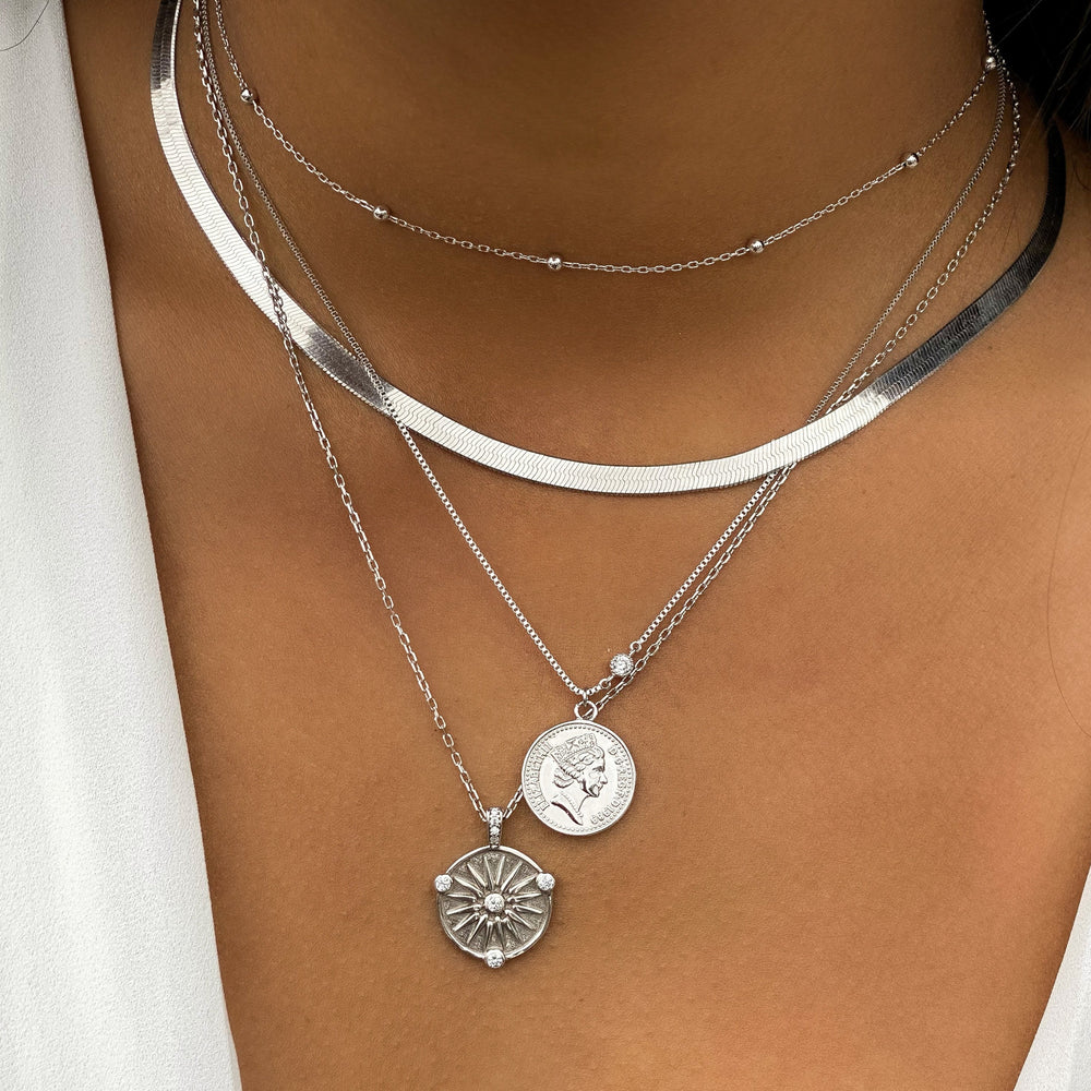 Wearing our sterling silver compass coin necklace | Alexandra Marks