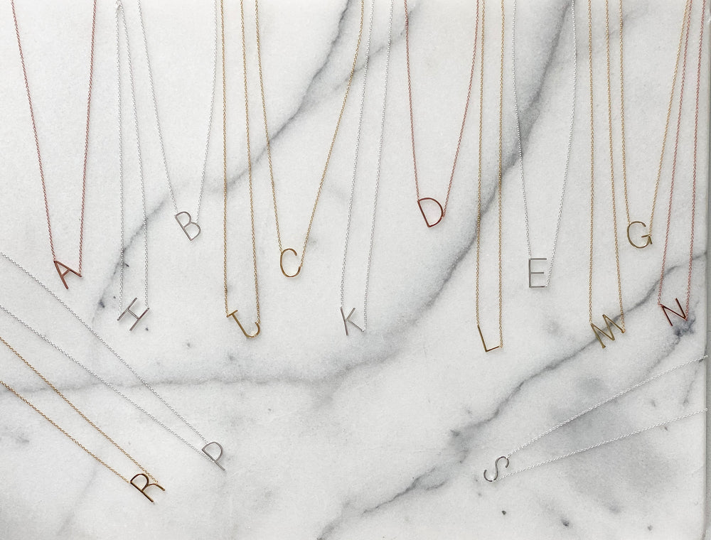 Alexandra Marks initial jewelry collection in silver, gold and rose gold