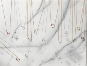 Best selling sideways initial necklaces in gold, silver and rose gold from Alexandra Marks Jewelry
