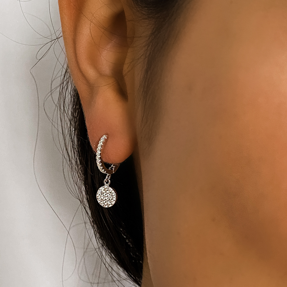 Load image into Gallery viewer, Wearing the silver disc charm hoop earrings