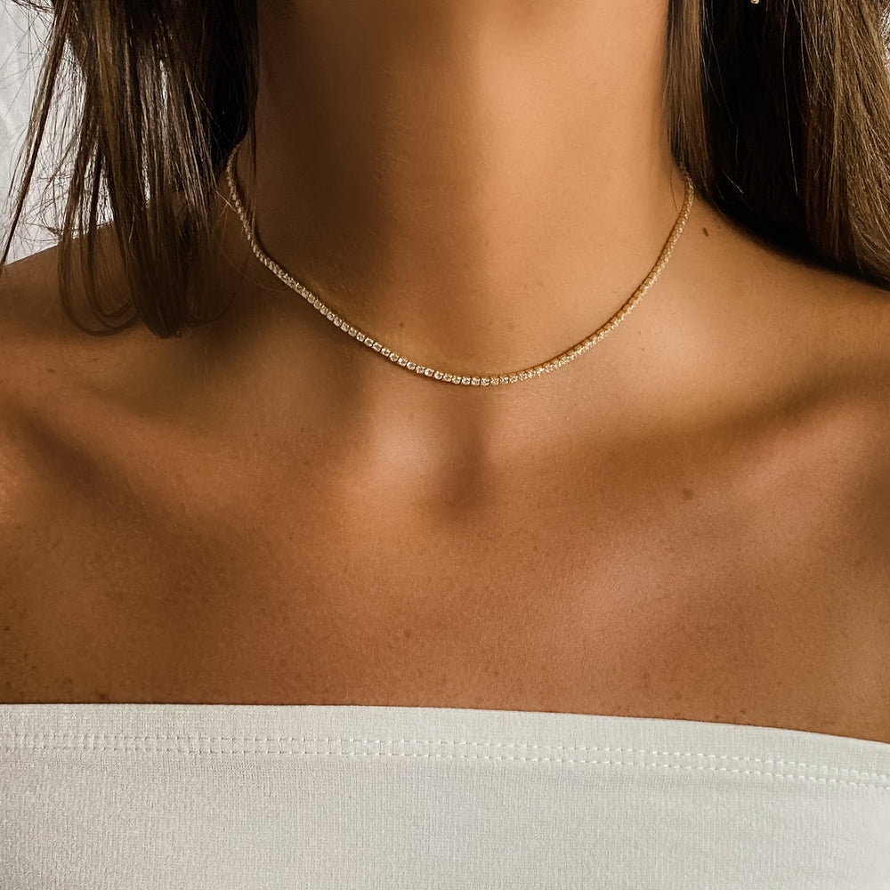 Wearing the thin gold tennis necklace from Alexandra Marks Jewelry