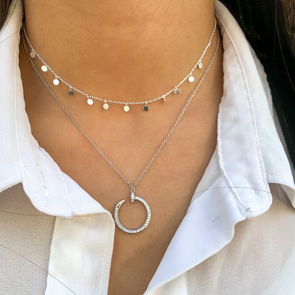 Wearing the silver Curved Nail Necklace from Alexandra Marks Jewelry