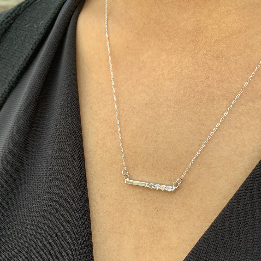 Simple diamond bar necklace in 14kt white gold from Alexandra Marks Jewelry