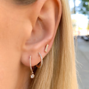 Wearing our 14kt rose gold & diamond small huggie hoop earrings
