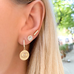 Wearing the gold halo stud earring in our second earring hole