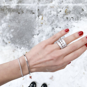 Alexandra Marks stacking two of the baguette cz eternity bands with a round eternity band