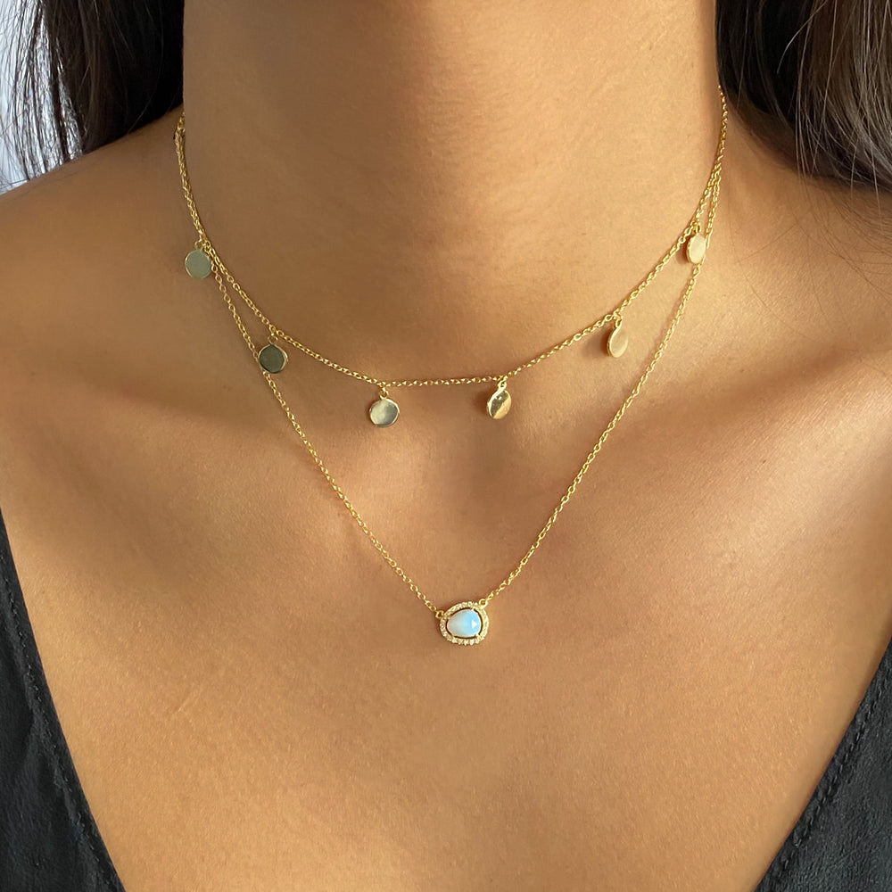 Wearing the gold opal free form necklace from Alexandra Marks Jewelry