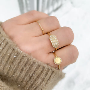 Stacking our diamond halo ring with our 14kt gold and diamond fashion rings