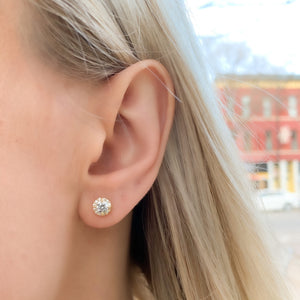 Wearing our gold cz halo stud earrings
