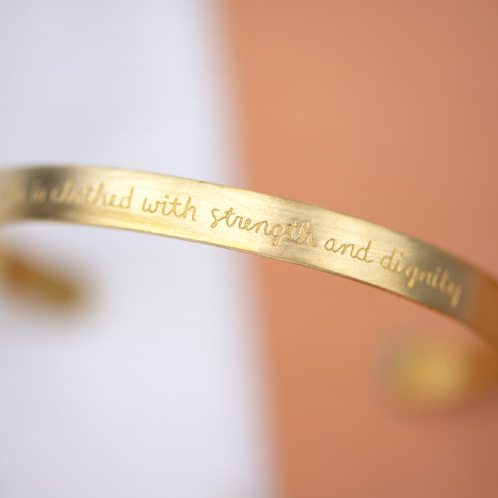 She is Clothed in Strength and Dignity (Proverbs 31:25) - Brass Cuff