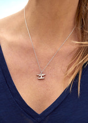 the cleat necklace from a yacht clothing company