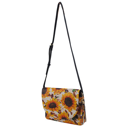 Cow Print with Sunflower NGIL Tassel Accessory Faux Leather Crossbody Bag