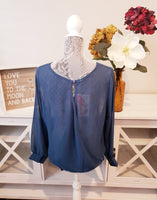 Sheer cross-over blouse