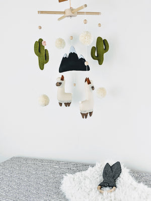 Baby gift from curated gift boutique. This set is the cutest keepsake yet, it includes a llama, cactus mobile and modern black and white changing pad cover