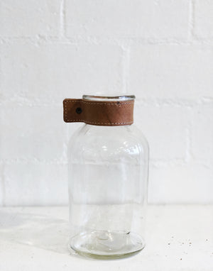 Glass vase with leather accent