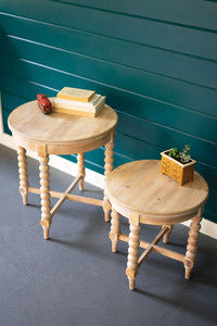 Round wooden side tables with turned legs