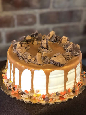 If you love everything peanut butter, this is the ice cream cake for you! It's covered shamelessly in a peanut butter layer, joined by chopped Reese's cups and chocolate whipped cream on the rim of the cake. To complete this peanut butter dessert we've included a garnish of Reese's Pieces to make the ideal peanut butter cake.
