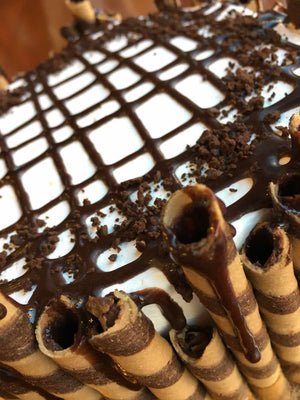 Our Chocolate Mocha ice cream cake is completely surrounded by chopped mocha sticks that are drizzled with chocolate fudge. We layer the fudge along the top of the cake in a crisscrossing pattern and add chocolate cake crunch as a final touch.