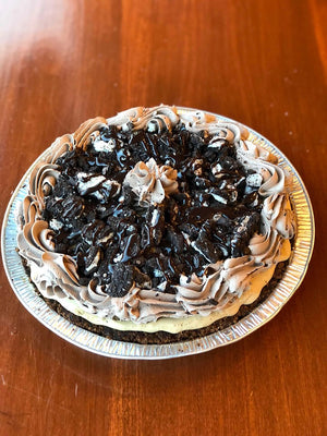 Coffee ice cream pie is made with a chocolate pie crust filled with delicious homemade coffee ice cream.