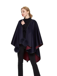 Double face cashmere cape with fox pom pom