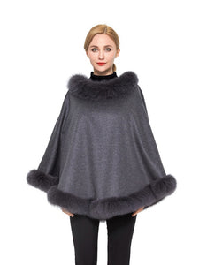 Cashmere poncho with fox trim