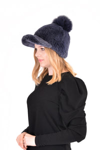 Knitted mink cap with fox fur pom pom
