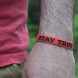 Red and Black Stay TRUE Wristband Lifestyle